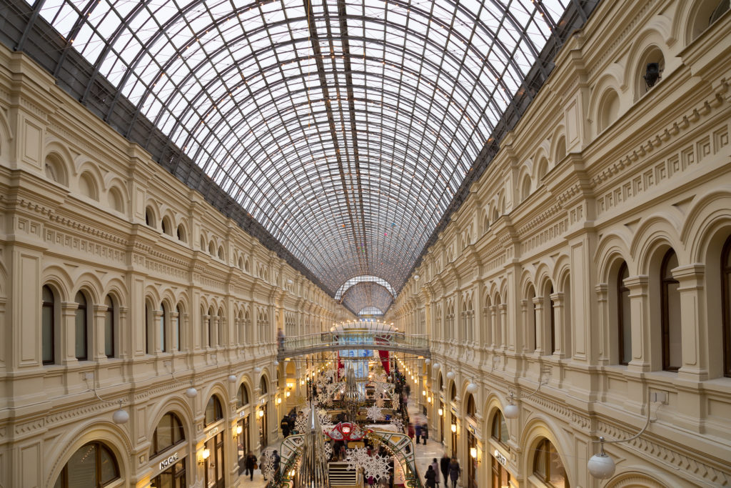 Interior of the Main Universal Store (GUM) on the Red Square in Moscow, Russia. This mall celebrates 120th aniversary in 2013. Inside view of the impressive structure and finish applied to the building