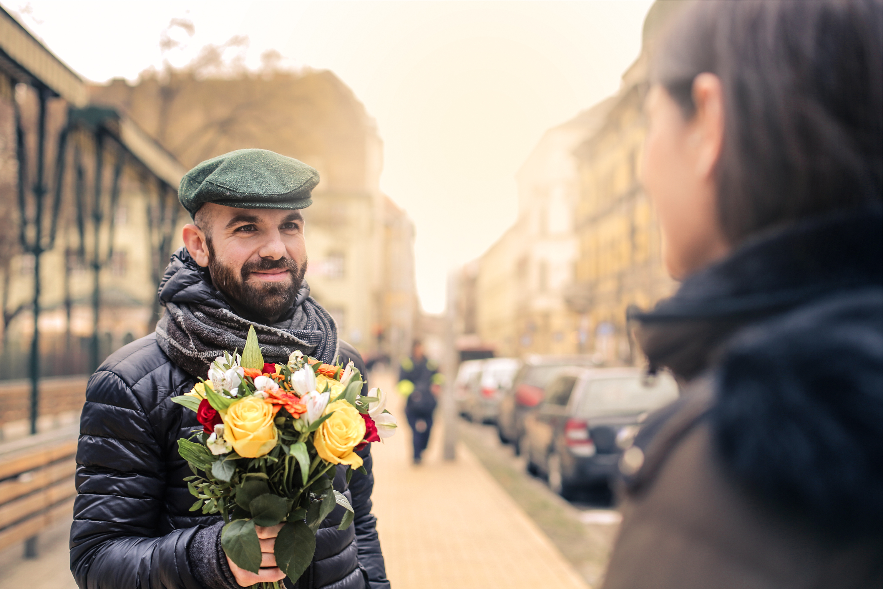 8 of March, a man giving flowers